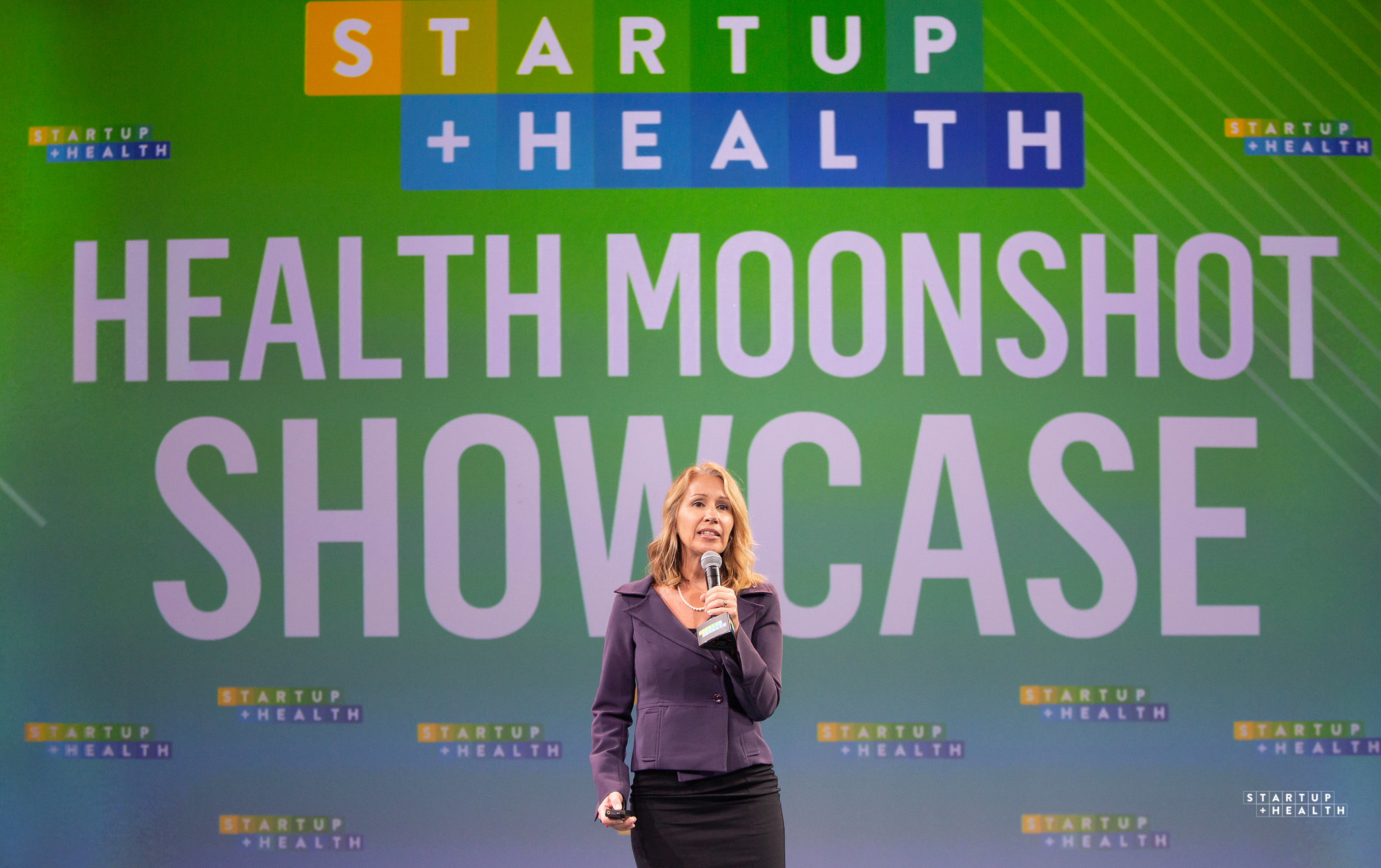 Curatio CEO Lynda Brown-Ganzert presenting at the 2019 StartUp Health Festival's Health Moonshoot Showcase.