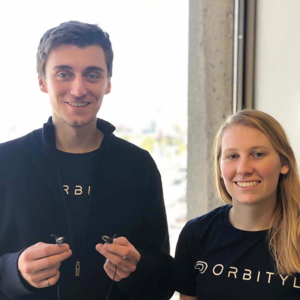 Co-Founders Kristina Pearkes (right) and Sean Kaiser (left) bring brain imaging in an earbud to reality.