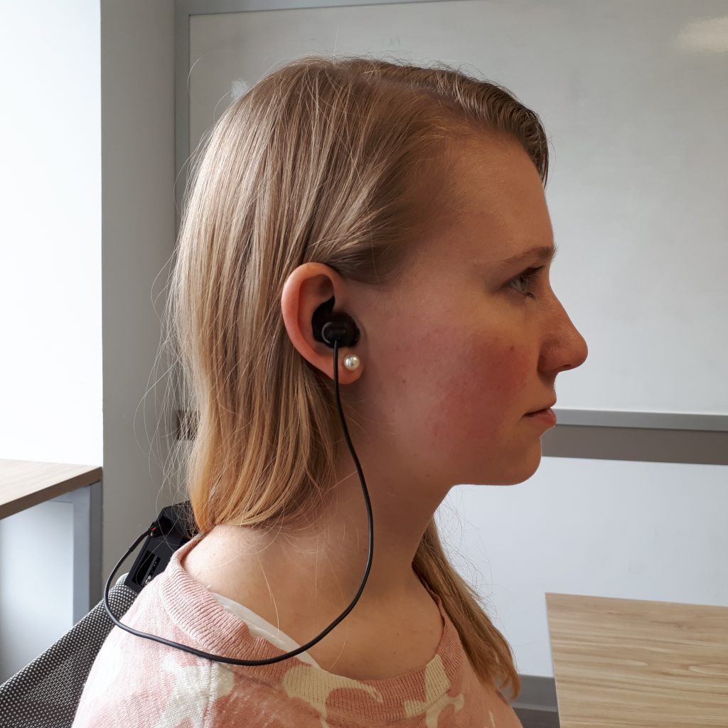 Kristina Pearkes, CTO of Orbityl, wears the earbud headphones monitoring brain activity from inside the ear with the sensors integrated within.