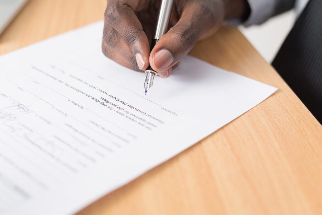 Entrepreneur signing corporate documents