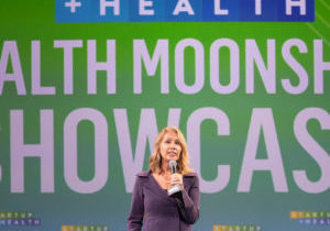 Curatio CEO Lynda Brown-Ganzert presenting at the 2019 StartUp Health Festival's Health Moonshoot Showcase.