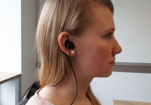 Kristina Pearkes, Co-Founder and CTO of Orbityl, wears the earbud headphones monitoring brain activity from inside the ear with the sensors integrated within.