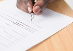 Entrepreneur signing corporate documents